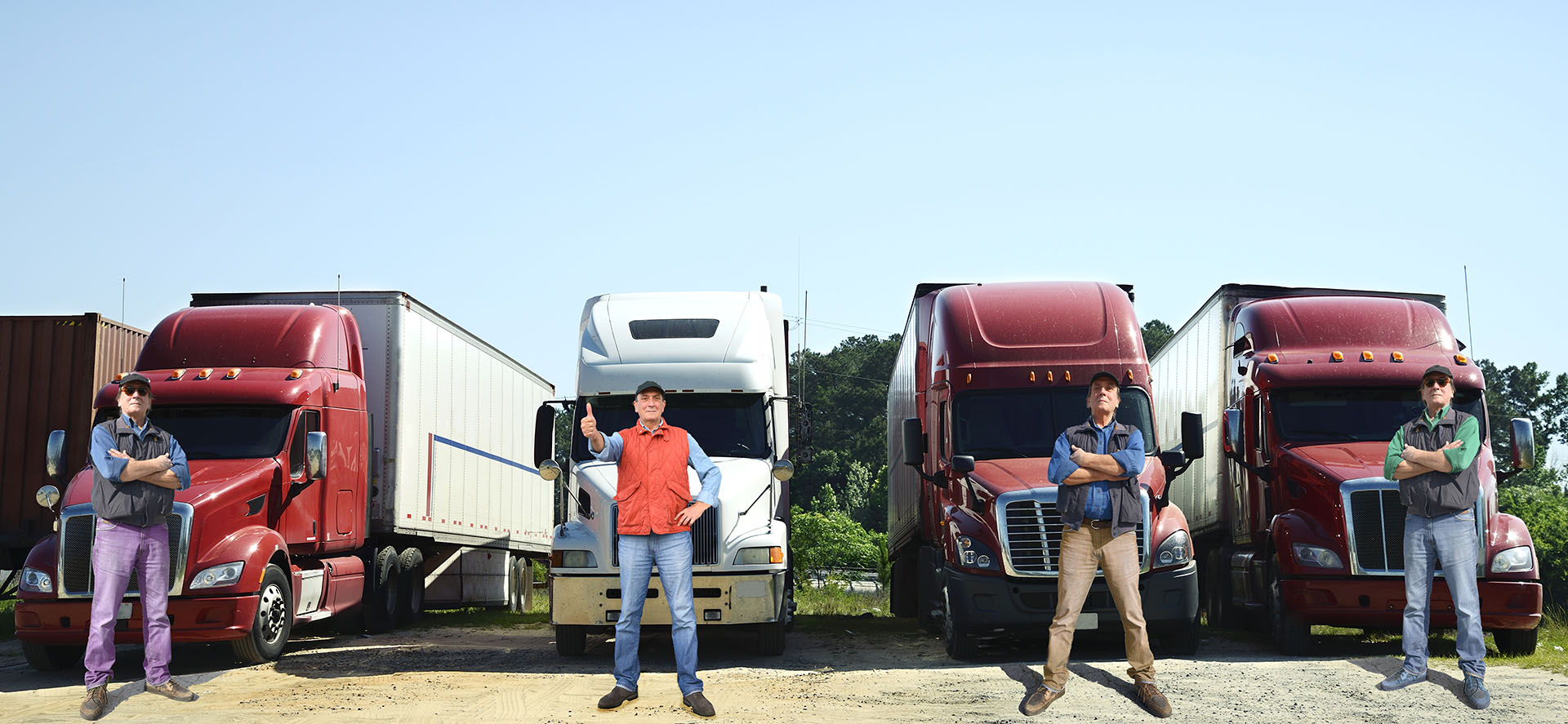 row of truck drivers in front of row of trucks